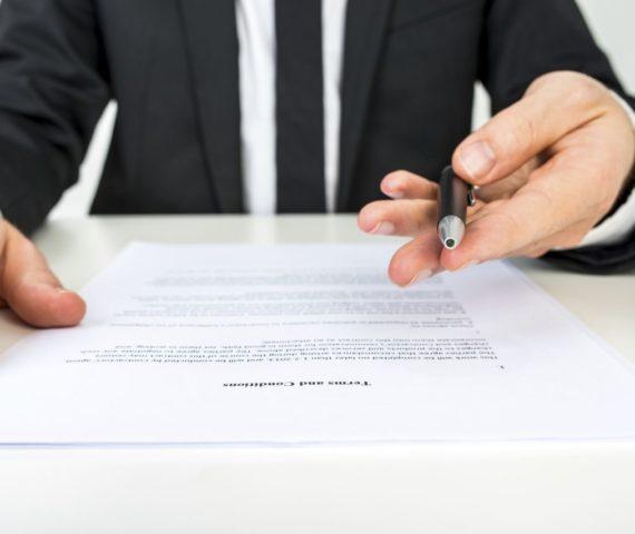 Contract_settlement_sign_pen-90a7325f2f0ecc9496da11dce20aecdda9dc25e9